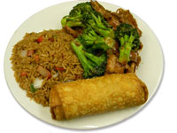 Kung Pao chicken with fried rice and egg roll.
